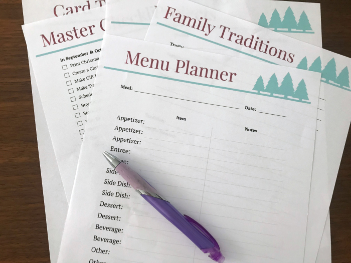Christmas planner sheets and a pen on a table