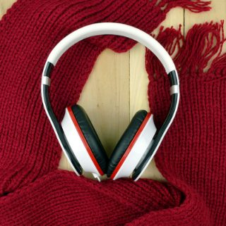 Headphones and red knitted scarf