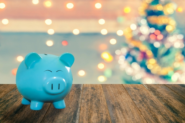 Blue pig bank on wood plank with sparkle blur Christmas tree. You can apply for blur Christmas wallpaper, blur Christmas background, blur Christmas backdrop blur and everything about Christmas celebration background and artwork design.