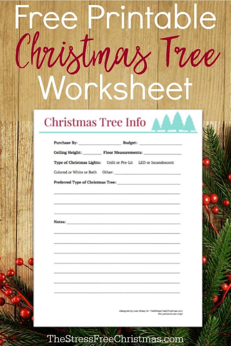 wooden background with artificial christmas tree branches and printable worksheet