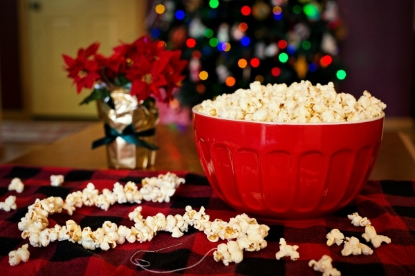 popcorn in red bowl in front of Christmas tree