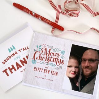 christmas cards laying on table