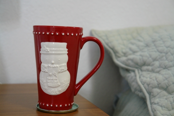 Christmas mug on bedside table.