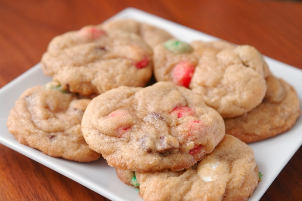 christmas M&M cookies on a white plate