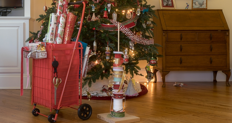 gift wrapping organizer cart in front of Christmas tree