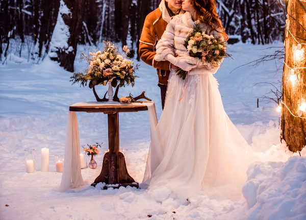 winter wedding with couple outside in snow