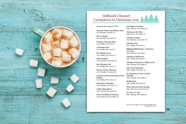 Cup of hot cocoa or chocolate with marshmallow and hallmark christmas movie schedule
