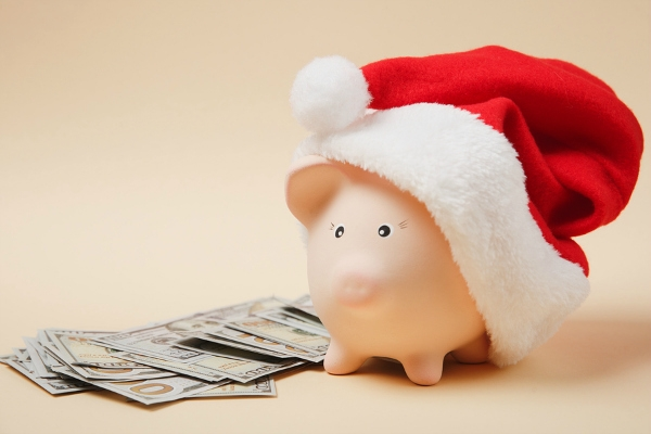 Piggy bank with Christmas hat bunch of dollars