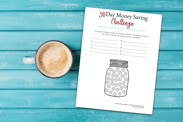 cup of coffee and money saving challenge worksheet on turquoise wooden table top