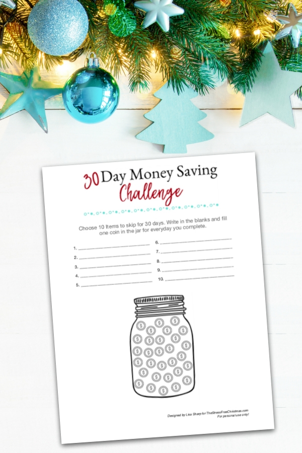 christmas decorations and money saving challenge worksheet on white table
