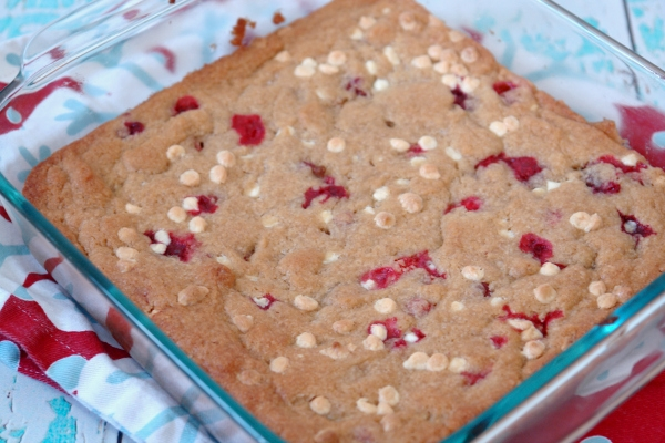 cranberry white chocolate brownies in pan on Christmas dish towel