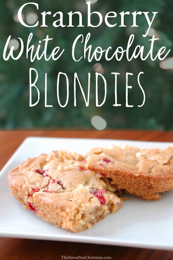 two cranberry white chocolate blondes on white plate in front of Christmas tree