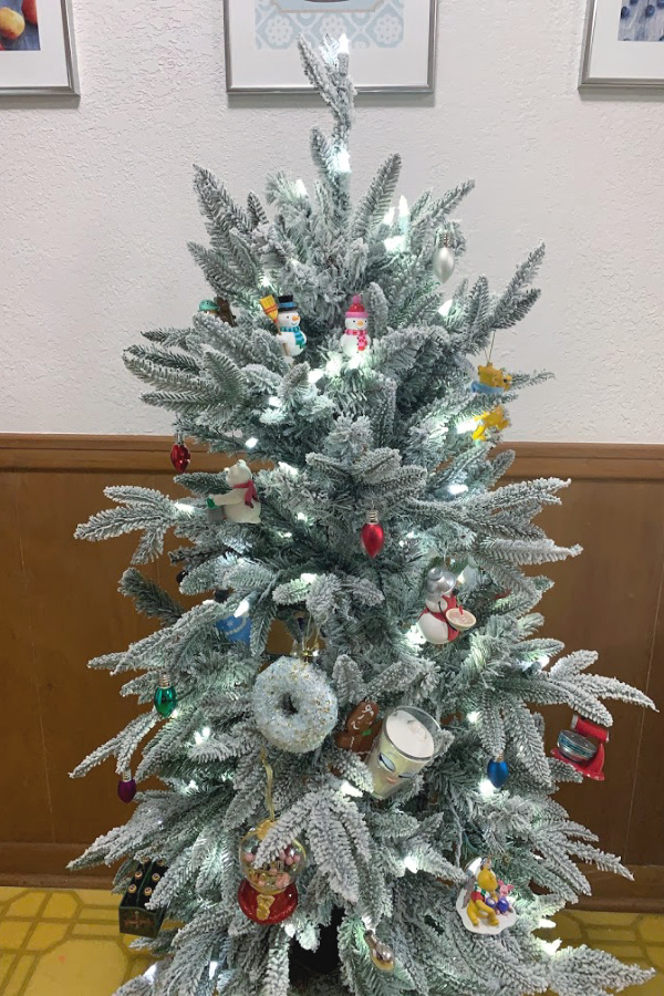 small flocked tree with food-related ornaments