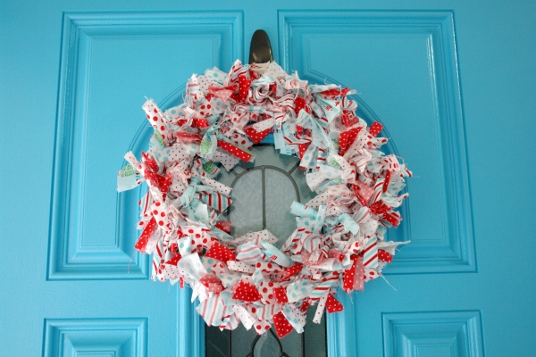 red and aqua rag wreath on blue door