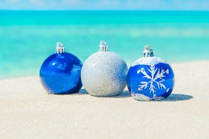 Christmas tree decorations on sea beach sand