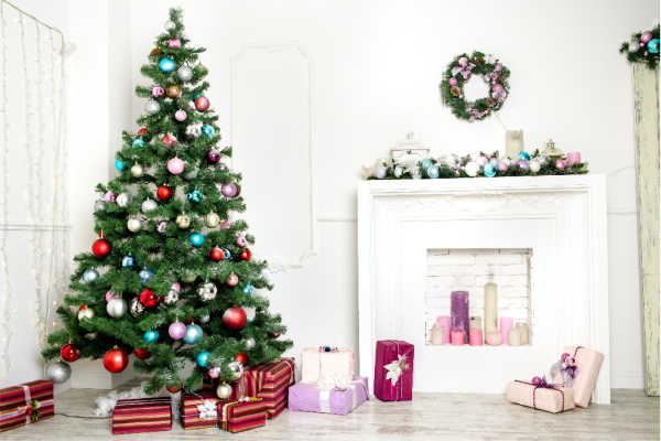 Christmas tree with colorful ornaments and gifts under it