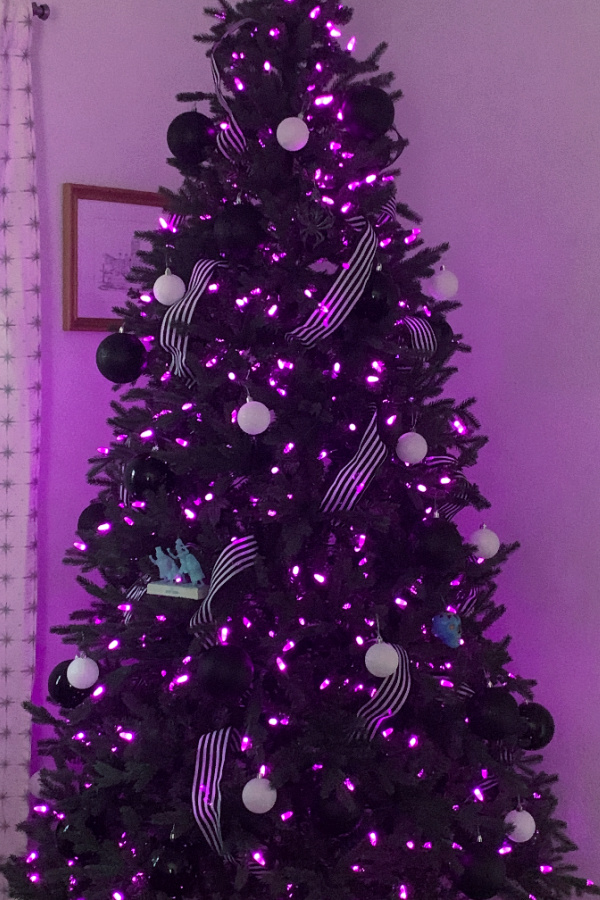 halloween tree with purple lights and black and white ornaments