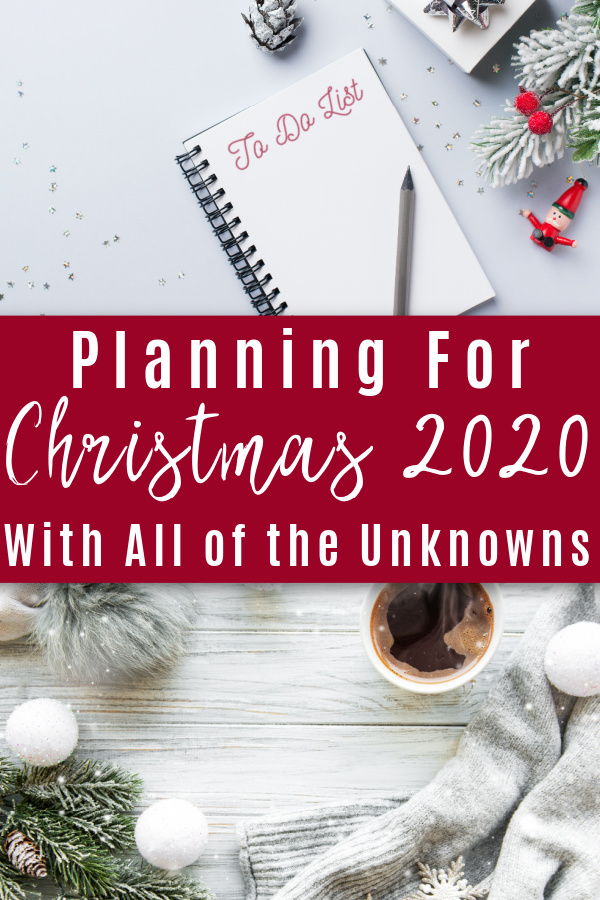 to-do list in notebook on table with Christmas decor and coffee