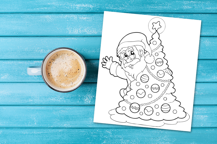 cup of coffee and Santa coloring page on blue wooden table