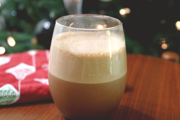 peppermint mocha whipped coffee in glass in front of Christmas tree