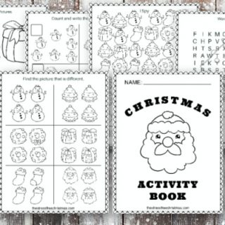 christmas activity book pages on wooden snowy background