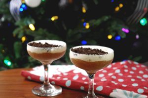 black and White Christmas cocktails in front of christmas tree