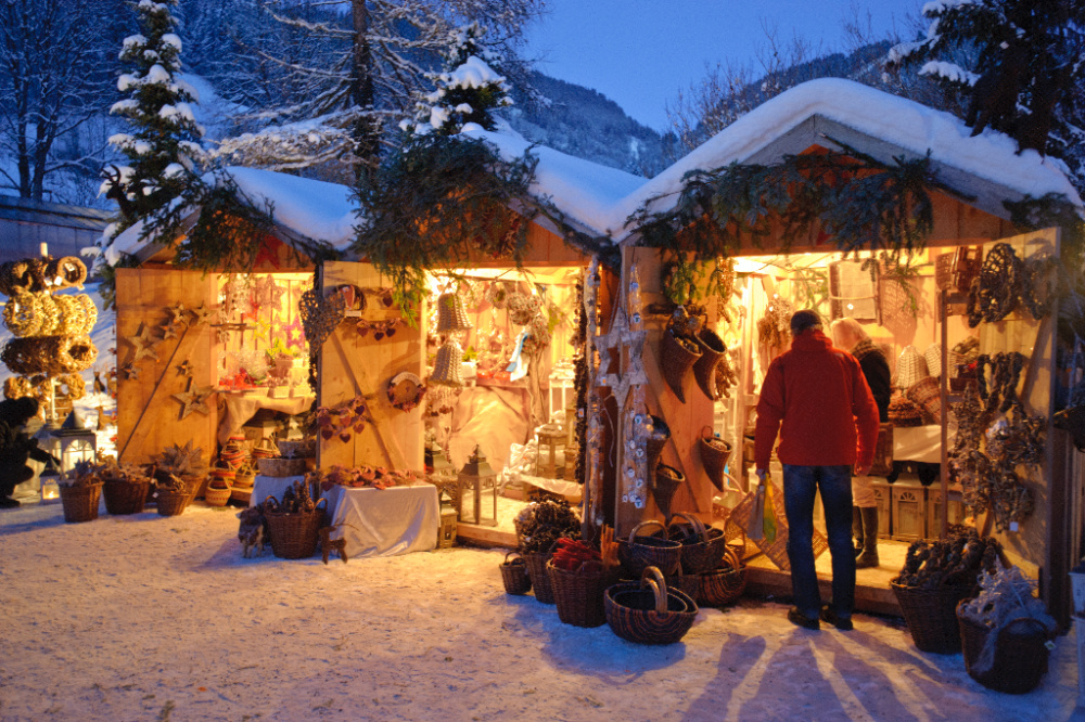 holiday market booths with person shopping