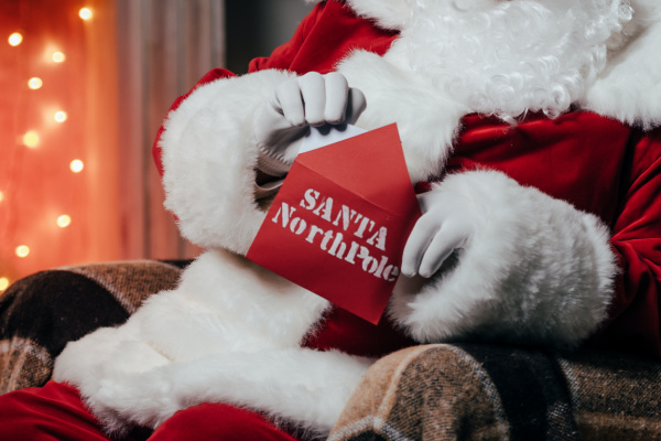 santa opening a red envelop