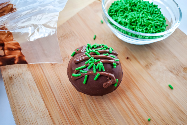 finished hot chocolate bomb with green sprinkles