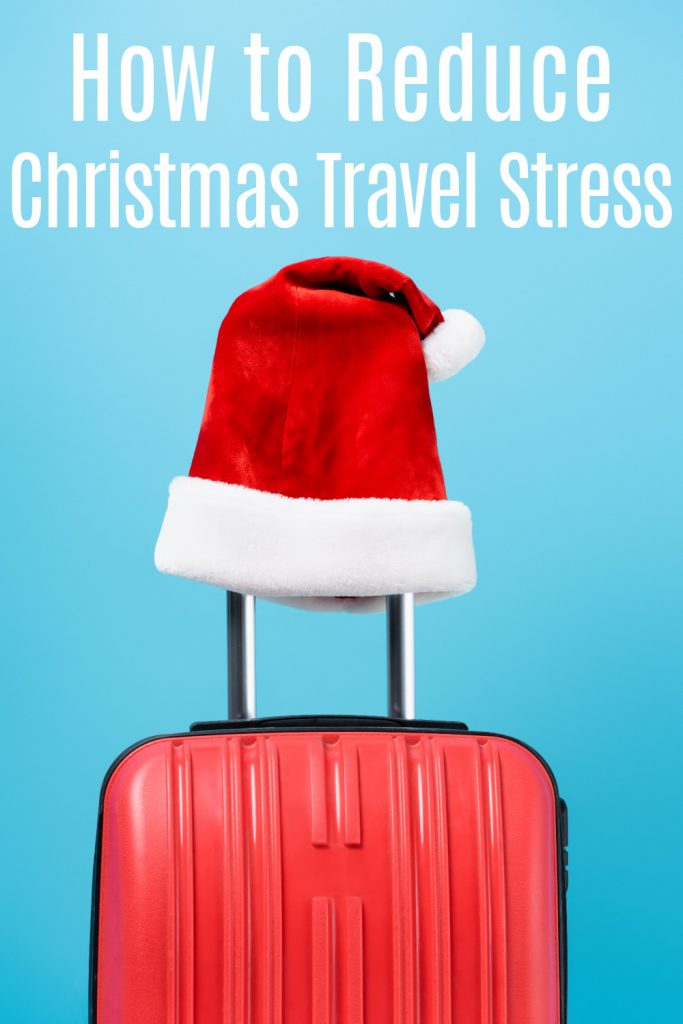 red suitcase with Santa hat on handle with blue background with text reading how to reduce christmas travel stress