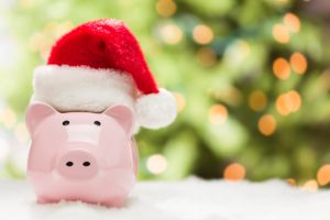 Pink Piggy Bank Wearing Red and White Santa Hat