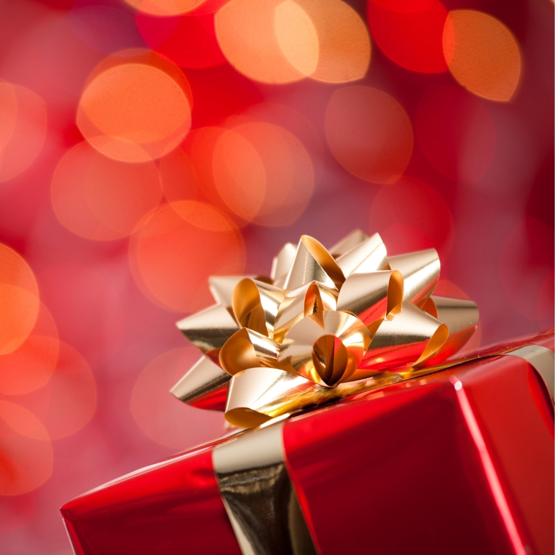 red gift in front of red background